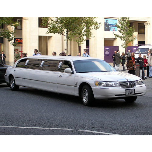A photo of one of our stretch limousines picking up clients at Uncle Remus restaurant in Broadview